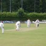 cory-atkinson-looks-to-defend-a-ball-from-the-ucc-bowlers