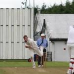 young-cork-county-bowler-james-duggan-in-full-flight-against-cork-harlequins
