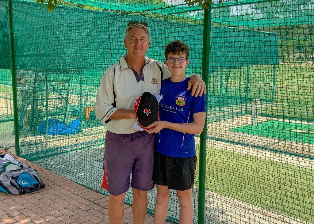 Daniel Kennedy presents Wim Jansen with a Munster cap